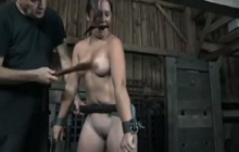 Brunette gets punished in a cage