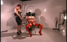 Slave in latex enjoys breath play
