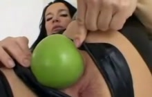 Fruit insertion inside her ass